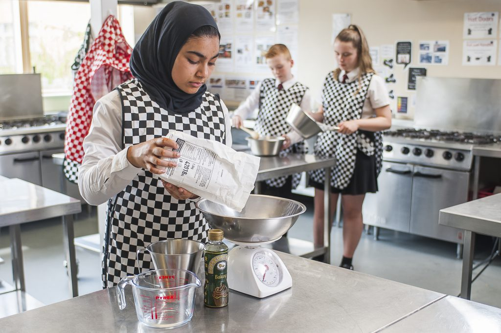 Students baking during a food technology lesson