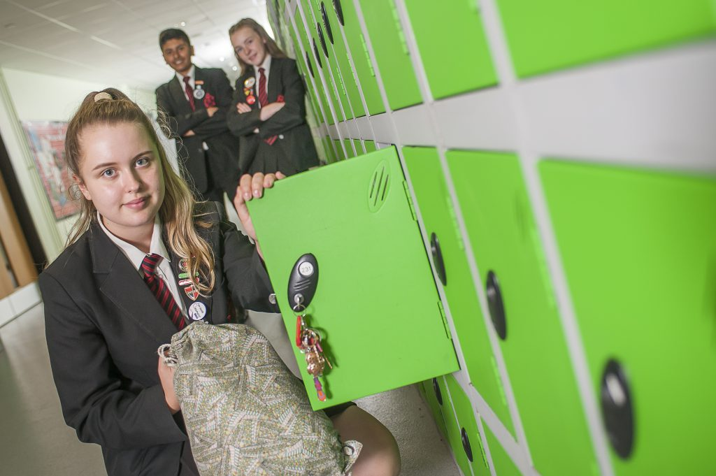 Students beside their school lockers