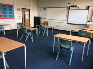 Photos 2a and 2b – Classroom set up for 8 students