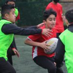 students play rugby